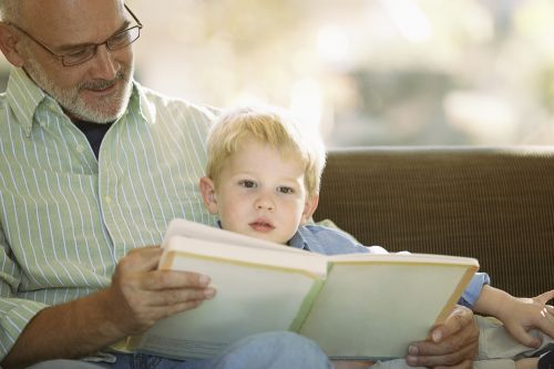 Grandpa reading with grandson